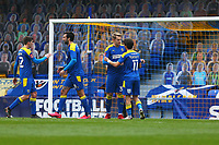 Joe Pigott of AFC Wimbledon scores the first goal for his team and celebrates during AFC Wimbledon vs Crawley Town, Emirates FA Cup Football at Plough Lane on 29th November 2020