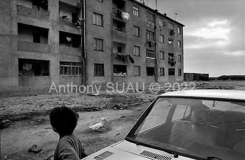 Sector Adriatic, Albania<br /> February 1997<br /> <br /> Housing intended for political internment is now occupied by poor Albanians who have moved from the northern regions, which is even more impoverished. All of the people in the complex lost money in the pyramids.