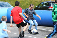 Young fans enjoy playing football during the 2016/17 Kit Launch of Wycombe Wanderers to the public at Adams Park, High Wycombe, England on 10 July 2016. Photo by David Horn.