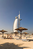 Dubai.  View over beach of Jumeirah Beach Hotel of Burj al Arab Hotel, architect W.S. Atkins, an icon of Dubai built in the shape of the sail of a dhow, stands on an island off Jumeirah Beach.  .