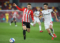 Sergi Canos of Brentford races after the ball as Rotherham's Ryan Giles looks on during Brentford vs Rotherham United, Sky Bet EFL Championship Football at the Brentford Community Stadium on 27th April 2021