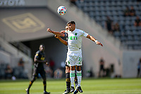 LOS ANGELES, CA - APRIL 17: Rodney Redes #11 of Austin FC  heads a ball during a game between Austin FC and Los Angeles FC at Banc of California Stadium on April 17, 2021 in Los Angeles, California.