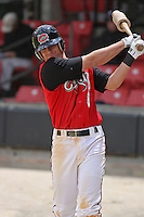 Zach Cozart of the Carolina Mudcats swing in the on-deck circle versus the Huntsville Stars on April 22, 2009 at Five County Stadium in Zebulon, NC