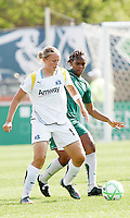 Christie Welsh (white) shielding the ball from Kia McNeil...Saint Louis Athletica and LA Sol, played to a 0-0 tie at Robert Hermann Stadium in St Louis, MO. April 25 2009.