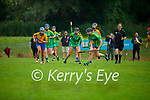 Kerry's Annemarie Leen and Clare's Emma Kennedy race to the sliotar for possession, in the Munster Junior Camogie final
