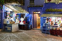 Chefchaouen, Morocco.  Neighborhood Sundries Shops in the Medina at Night.