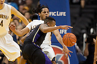 Jorge Gutierrez takes the charge from Isaiah Thomas. The Washington Huskies defeated the California Golden Bears 79-75 during the championship game of the Pacific Life Pac-10 Conference Tournament at Staples Center in Los Angeles, California on March 13th, 2010.