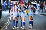 """© Joel Goodman - 07973 332324 . 27/12/2016 . Wigan , UK . Three women wearing baseball uniforms with """"Out of your league 10"""" printed across their backs . Revellers in Wigan enjoy Boxing Day drinks and clubbing in Wigan Wallgate . In recent years a tradition has been established in which people go out wearing fancy-dress costumes on Boxing Day night . Photo credit : Joel Goodman"""