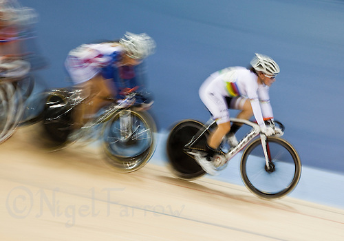 18 FEB 2012 - LONDON, GBR - Canada's Tara Whitten (CAN) (in white) leads the USA's Sarah Hammer during the Women's Omnium Elimination Race at the UCI Track Cycling World Cup, and London Prepares test event for the 2012 Olympic Games, in the Olympic Park Velodrome in Stratford, London, Great Britain .(PHOTO (C) 2012 NIGEL FARROW)