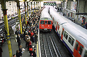Commuters pack the platform at London's Farringdon tube station during the morning rush hour.