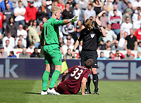 Pictured: Joe Hart of Manchester City (L) asks his team physios to stay put, while match referee Mike Jones (R) requests their attendance for Matija Nastasic (C) of Manchester City who is injured on the ground,  Saturday 04 May 2013<br /> Re: Barclay's Premier League, Swansea City FC v Manchester City at the Liberty Stadium, south Wales.