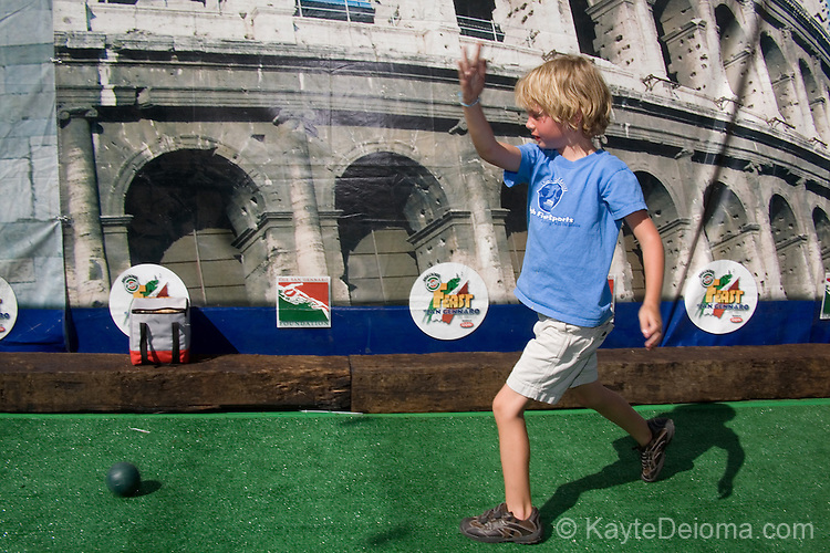 Blond boy playing Bocce at the Feast of San Gennaro - Los Angeles, CA