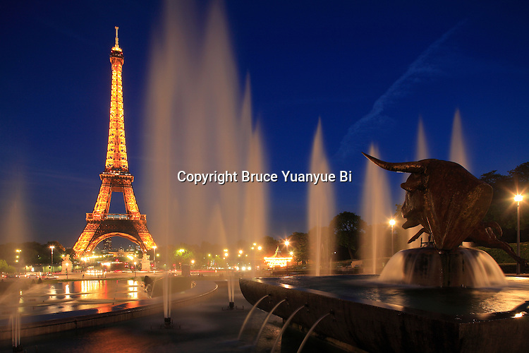 The night view of Eiffel Tower with the fountains of Jardins Trocadero in foreground. City of Paris. Paris. France