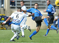 24 October 2004:  Brian Mullan of Earthquakes tries to block Jose Burciaga's kick at Spartan Stadium in San Jose, California.     Earthquakes defeated Wizards, 2-0.  Credit: Michael Pimentel / ISI