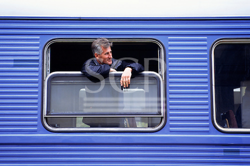 Sarajevo, Bosnia and Herzegovina. Man looking out of the train window; ZBH sign.