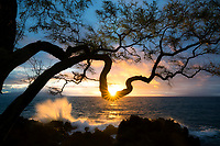 Sunset with sunburst and waves. Wailea Maui.