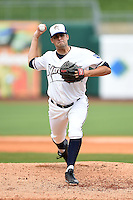 NW Arkansas Naturals pitcher Andrew Triggs (31) delivers a warmup pitch during a game against the Corpus Christi Hooks on May 26, 2014 at Arvest Ballpark in Springdale, Arkansas.  NW Arkansas defeated Corpus Christi 5-3.  (Mike Janes/Four Seam Images)