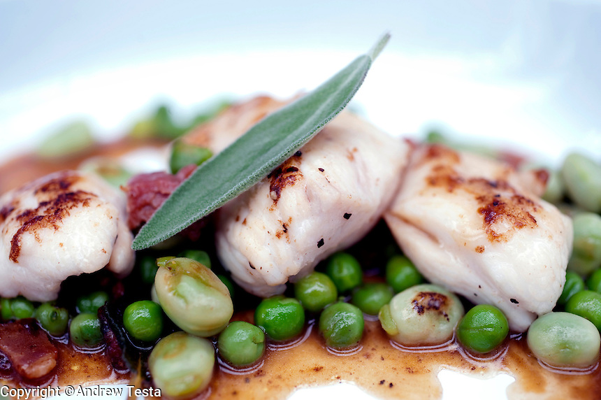 UK. London. 17th July 2010.Sauted Monkfish Cheeks with Bacon, Sage, Peas and Broad Beans at Brixton Cornercopia..©Andrew Testa for the New York Times