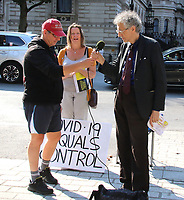 Outspoken activist Piers Corbyn - brother of former labour Leader Jeremy - was seen campaigning opposite Downing Street, speaking to a crowd about his Covid-19 Conspiracy theory. He arrived in Westminster with several campaign placards then met up with fellow activists in Whitehall. The astrophysicist has been addressing crowds throughout lockdown saying that the Covid-19 outbreak was designed to control population. London September 16th 2020<br /> <br /> Photo by Keith Mayhew