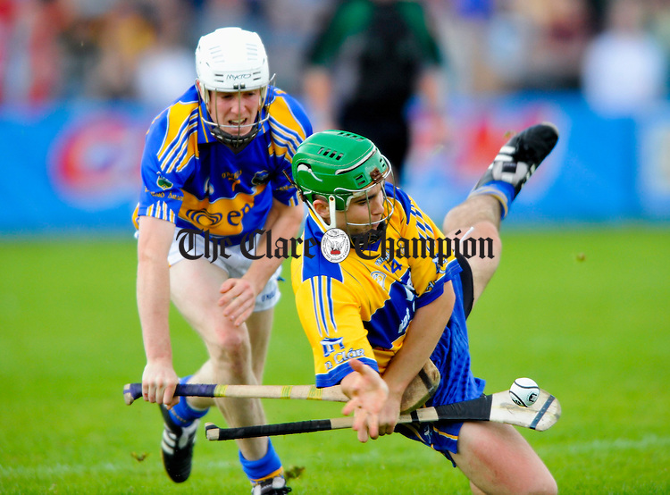 Clare's Caimin Morey in action against Tipperary's Michael Cahill during the Munster U-21 final at Cusack Park. Photograph by John Kelly.