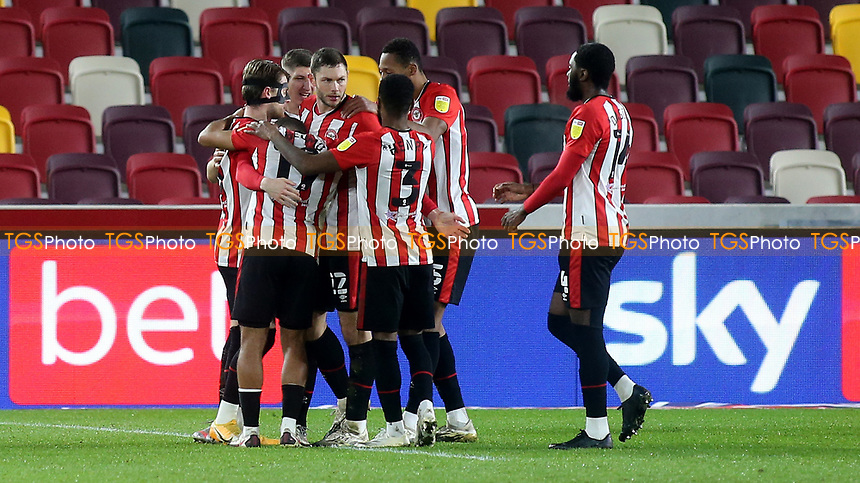 Brentford players congratulate Henrik Dalsgaard after scoring their opening goal during Brentford vs AFC Bournemouth, Sky Bet EFL Championship Football at the Brentford Community Stadium on 30th December 2020