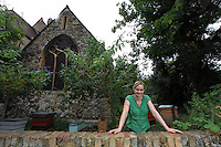 """Camilla Goddart, 38 years old, posing in front of her first hive in the garden of St Peters Church in Brocley where she started 8 years ago. Since, this graphic designer by training created a company, """"Capital Bee"""", that sells honey in the markets or in shops and cafÈs like Broca Market, Brockley, The Frog on the Green Deli in Nunhead, Cafe Crema in New Cross and El's Kitchen in Ladywell.<br /> """"I go through various obsessions, when I was young it was growing tropical fruit, when I was at Cambridge it was English Literature, then art, then japanese woodcuts, then extraordinary victorian copper jellymoulds for puddings at banquets, then herbs and their uses, then decorative vegetable gardens and making potagers, then antique african masks, though in the end keeping bees has proved to be the most enduring as they are so complex and are teaching me all the time about their mysterious world.  I even look after nests of bumblebees now in wooden boxes in the apiary they are terrific characters, people get them mixed up with bees and sometimes want them removed, though it is always best to leave them alone ideally as they rarely do any harm ª"""