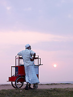Food seller on the promenade at sunset, Galle, Sri Lanka
