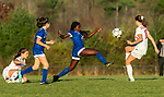 LITCHFIELD, CT-110620S20 —Litchfield's Jeremina Prenoveau (22) tries to chip the ball over Northwestern's Melissa Tatsapaugh (10) during their Berkshire League game Friday at Litchfield High School. <br /> Jim Shannon Republican-American