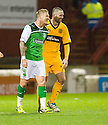 MICHAEL HIGDON SHARES A JOKE WITH HIBERNIAN'S GARRY O'CONNOR AFTER HE CELEBRATES SCORING MOTHERWELL'S THIRD GOAL WITH AN OVER HEAD KICK