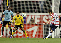 COLUMBUS, OHIO - SEPTEMBER 11, 2012:  Jose Torres (16) of the USA MNT blasts a shot at Adrian Mariappa (19) and Dwayne Miller (13) of  Jamaica during a CONCACAF 2014 World Cup qualifying  match at Crew Stadium, in Columbus, Ohio on September 11. USA won 1-0.