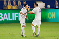 CARSON, CA - OCTOBER 07: Los Angeles Galaxy team mates Cristian Pavon #10 and Emiliano Insua #3 celebrate during a game between Portland Timbers and Los Angeles Galaxy at Dignity Heath Sports Park on October 07, 2020 in Carson, California.