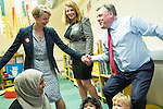 © Joel Goodman - 07973 332324 . 14/06/2016 . Blackburn , UK . Yvette Cooper MP helps her husband , former MP Ed Balls , stand up from a child's seat during a campaign for Remain , in the EU referendum , at Shadsworth Children's Centre in Blackburn . Photo credit : Joel Goodman