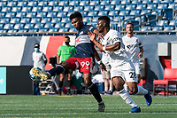FOXBOROUGH, MA - JULY 25: USL League One (United Soccer League) match. Orlando Sinclair #99 of New England Revolution II attempts to control the ball as Illal Osumanu #28 of Union Omaha pressures during a game between Union Omaha and New England Revolution II at Gillette Stadium on July 25, 2020 in Foxborough, Massachusetts.