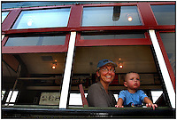 A grandmother rides on a trolly car with her grandson. Model released image can be used to illustrate many purposes.