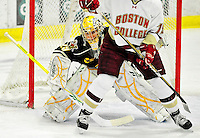 12 November 2010: University of Vermont Catamount goaltender Rob Madore, a Junior from Pittsburgh, PA, tries to look around Boston College Eagle forward Chris Kreider, a Sophomore from Boxford, MA, at Gutterson Fieldhouse in Burlington, Vermont. The Eagles edged out the Cats 3-2 in the first game of their weekend series. Mandatory Credit: Ed Wolfstein Photo