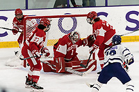 WORCESTER, MA - FEBRUARY 08: Mary Edmonds #13 of Holy Cross scores as shot slips behind Kate Stuart #1 of Boston University during a game between Boston University and College of the Holy Cross at Hart Center Rink on February 08, 2020 in Worcester, Massachusetts.