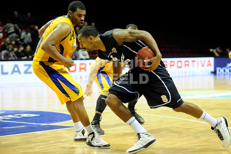 GRONINGEN -   Groninger Basketball Week, Martiniplaza, 31-12-2012,  kleine finale, Flames - Al Riyadi, .Flames speler Jason Dourisseau.