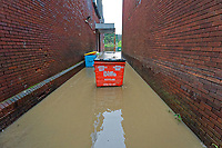 Pictured: A waste bin in a flooded lane in Pontypridd, Wales, UK. Sunday 16 February 2020<br /> Re: Storm Dennis has been affecting parts of Wales, UK.