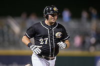Dan Black (27) of the Charlotte Knights rounds the bases after hitting a game tying home run in the bottom of the 9th inning against the Toledo Mud Hens at BB&T BallPark on April 27, 2015 in Charlotte, North Carolina.  The Knights defeated the Mud Hens 7-6 in 10 innings.   (Brian Westerholt/Four Seam Images)
