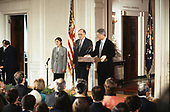 United States President Bill Clinton, right, makes remarks hosts a swearing-in ceremony for Associate Justice of the Supreme Court Ruth Bader Ginsburg, left, in the East Room of the White House in Washington, DC on August 10, 1993.  Looking on at center is Chief Justice of the United States William H. Rehnquist.  Justice Ginsburg replaces Associate Justice Byron R. White.<br />