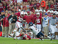STANFORD, CA - November 6, 2010: Anthony Wilkerson runs with the ball after a block by Andrew Luck during a 42-17 Stanford win over the University of Arizona, in Stanford, California.
