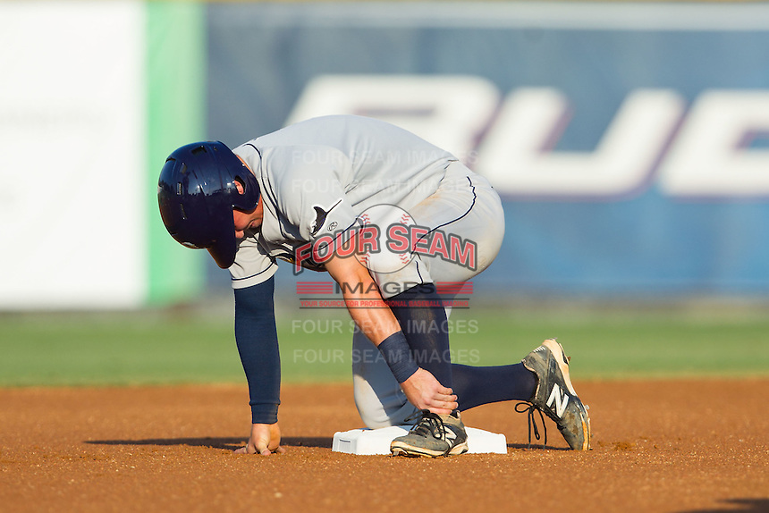 Riley Unroe (1) of the Princeton Rays grabs his left ankle after injuring it running from first to second base during the game against the Burlington Royals at Burlington Athletic Park on July 11, 2014 in Burlington, North Carolina.  The Rays defeated the Royals 5-3.  (Brian Westerholt/Four Seam Images)