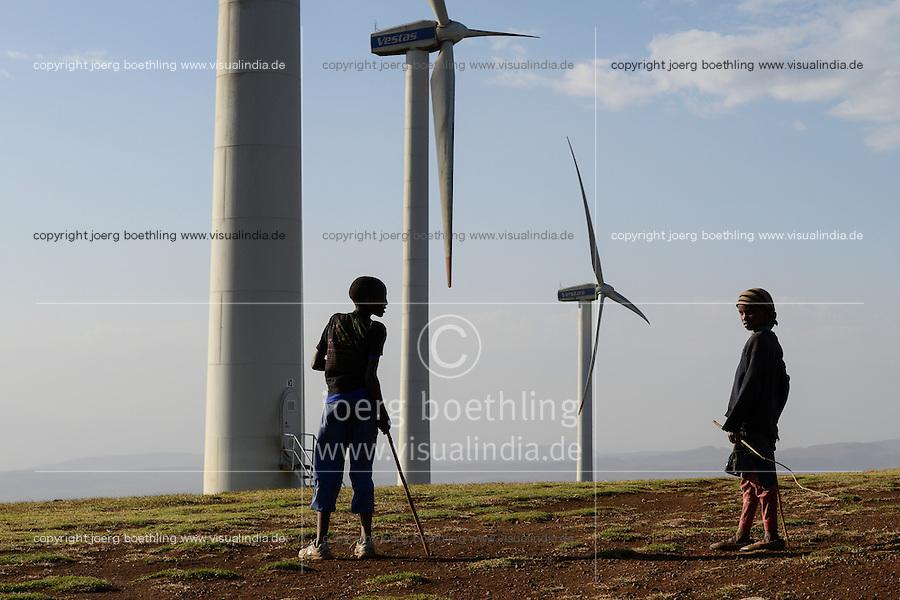 KENYA, Nairobi, Ngong Hills, 25,5 MW Wind Power Station with Vestas wind turbines, owned and operated by KENGEN Kenya Electricity Generating Company, young shepherd, view to Great Rift valley / KENIA, Ngong Hills Windpark, Betreiber KenGen Kenya Electricity Generating Company mit Vestas Windkraftanlagen, junge Hirten, Blick zum grossen afrikanischen Grabenbruch