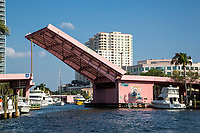 Ft. Lauderdale, Florida.  Andrews Avenue Drawbridge over New River Opening for Approaching Boat with Tall Mast.
