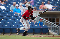 Freddy Zamora (23) of the Carolina Mudcats follows through on his swing against the Kannapolis Cannon Ballers at Atrium Health Ballpark on July 18, 2021 in Kannapolis, North Carolina. (Brian Westerholt/Four Seam Images)