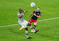 WASHINGTON, DC - NOVEMBER 8: Paul Arriola #7 of D.C. United takes a shot past Rod Fanni #7 of the Montreal Impact during a game between Montreal Impact and D.C. United at Audi Field on November 8, 2020 in Washington, DC.