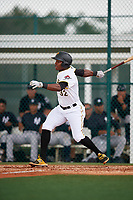 GCL Pirates designated hitter Joseivin Medina (32) follows through on a swing during the second game of a doubleheader against the GCL Yankees East on July 31, 2018 at Pirate City Complex in Bradenton, Florida.  GCL Pirates defeated GCL Yankees East 12-4.  (Mike Janes/Four Seam Images)