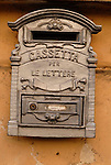 Letterbox on a wall in the Parione district of Rome.