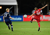 LAKE BUENA VISTA, FL - JULY 26: Auro of Toronto FC plays the ball out of the air while Gary Mackay-Steven of New York City FC looks on during a game between New York City FC and Toronto FC at ESPN Wide World of Sports on July 26, 2020 in Lake Buena Vista, Florida.