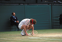 3rd July 1980: American player JOHN McENROE sinks to his knees in anguish during his Wimbledon Men's Singles Final defeat to Borg Photo: Leo Mason/Action Plus...tennis loser losing disappointment lose man 8007